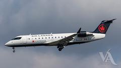 Air Canada Express CRJ-200 (C-GJZZ)-2.jpg (Vince Amato Photography) Tags: crj200 bombardier trudeauinternationalairport aircanadaexpress commercialairliner cgjzz cr2 crj2 cyul canada ggn jza kv montreal qk quebec skv yul zx