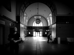 At the railway station (wojciechpolewski) Tags: blackandwhite blackwhite blanconegro photo photos railwaystation clock people