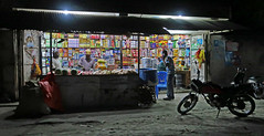 """""""A quart of milk and what else?"""" - Night store near Stonetown, Zanzibar (TravelsWithDan) Tags: night store men muslim city urban stonetown zanzibar tanzania africa colors candid streetphotography motorcycle onthephone canong9x"""