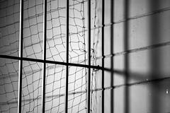 shadow (queue_queue) Tags: shadows screen net creepy dark bars gate