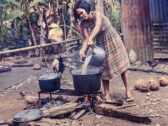 52-26: Village rice cooking (315Edith) Tags: canon 70d 50mm 52weekphotoproject environmentalportraits portrait woman ricecooking openfire cauldron pot backyard