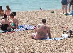 Southsea Beach, sunbathing (brieflives) Tags: beach seaside tattoo portsmouth southsea