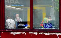 Reflections (graffpix) Tags: reflections westbromwich starandgarter people street pubwindow pubs windows advertisements adverts faces