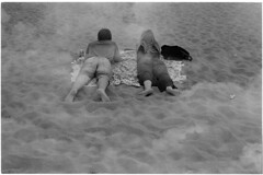 Magic carpet (Elios.k) Tags: horizontal outdoors people two man woman couple lyingonbeach beach sand relaxing beer chilling doubleexposure cloud cloudy sky overlap blackandwhite bw mono monochrome travel travelling may 2018 canon camera photography denhaag hague scheveningen netherlands nederland europe film analoguephotography scannedfilm kodaktrix400 analogfilm grain contrast canona1 a1 analogcamera