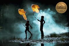 Fire Breathers (Dannis van der Heiden) Tags: firebreathing firebreather fire water pond mystic firesmoke smoke schnitzeljacht mist reflection grass people forest foliage nuenen netherlands man woman