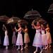 Ballerinas with umbrellas.