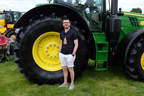 Harry was impressed by the large tractor wheels