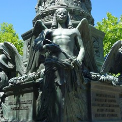 A Palmleaf for Egypt and Mexico. Statue for Maximilian, Emperor of Mexico, Piazza Venezia, Trieste, Italy (Rana Pipiens) Tags: egyptiantradition maximilianofmexico triesteitaly johannesschlling statue sword egypte wings angels archangels sculpture palmleaf sony