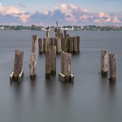 Prescott Pillars (Kevin Tataryn) Tags: dock old abandoned nikon d500 1755 water river stlawrence wharf port prescott ontario long exposure clouds sky