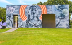 """San Jose Mural:  """"Sophie Holding the World Together"""", 2017, by muralist El Mac (Miles MacGregor) with the Propeller Group (jacklouis17) Tags: mural muralart sanjose immigration immigrationactivist 7yearsold discoverypark sanjosemuseumofart art sophie elmac propellergroup childrensdiscoverymuseum dramatic beautiful santaclaracounty"""