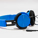 Vibrant blue headphones on white background