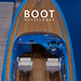 """Blaues Schnellboot mit Holzverkleidung von oben fotografiert, mit dem Bildtitel """"Boot Düsseldorf"""""""