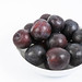 Fresh Raw Plums isolated above white background