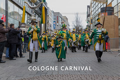 """Marching band with children, men and woman in guard costumes during rose Monday at Kölner Karneval, walking through the streets, with the picture title """"Cologne Carnival"""" (verchmarco) Tags: karneval cologne köln festival parade street strase city stadt people menschen flag flagge whiteclover weisklee celebration feier costume kostüm band editorial leitartikel pride stolz man mann music musik ceremony zeremonie demonstration traditional traditionell road geologicalformation geologischeformation event veranstaltung2019 2020 2021 2022 2023 2024 2025 2026 2027 2028 2029 2030 restaurant windows xmas countryside outside colours seascape naturaleza ciel christmastree"""
