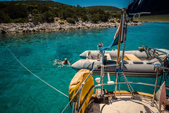 Turquoise waters...... (Dafydd Penguin) Tags: turquoise waters sea anchorage anchor mooring harbour bay creek harbor avon inflatable dinghy yacht yachting sailboat sail boat man person swim swimming rope blue ensign ship dhokos dokos saronic gulf greece aegean leica m10 sailing 21mm super elmar f34 asph