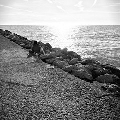 Secluded (Demmer S) Tags: summertime seaside rocks outdoors sky clouds person coast water sea ocean light people sitting beachchair peoplewatching secluded quiet relax peaceful calm silence serenity relaxing tranquil solitary rocky stones seashore seascape rock outside gulfcoast jetty pier summer seasonal seasons sunlight sun sunshine square squareformat bw monochrome blackwhite blackandwhite blackwhitephotos blackwhitephoto diagonal