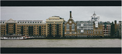 'Butler's Wharf' (Thomas Listl) Tags: thomaslistl color 16x7 cinematic architecture river thames waterscape buildings london uk greatbritain england water chimney facades 35mm wolfiwolf butler butlers butlerswharf riverthames grain mood