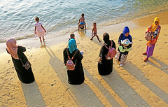 Mothers and Kids at the Beach - Stonetown, Zanzibar (TravelsWithDan) Tags: mothers children beach water ocean sand indianocean stonetown zanzibar tanzania africa candid sunsetlight fromabove city urban covered muslim colorful canong3x