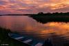 Sunset over Edgartown Great Pond (John Piekos) Tags: scenicview marthasvineyard sunset water massachusetts edgartown orange marsh pond clouds motorboat capecod boat reflection red newengland edgartowngreatpond