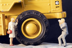 Modelphotographing at a toy Caterpillar 920's backwheel (Walter Johannesen) Tags: yellow caterpillar macro monday mondays wheels modelphotographing small wheel