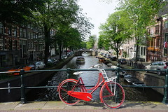 A Red Bike and The Canal (Ozrkca) Tags: landscape view sonyalphadslr 1650mm sony tree canal bike red reflection netherlands river amsterdam a6000