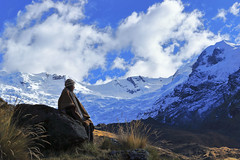Mujer y nevado (USAID Peru) Tags: woman unknownperson editorial contemplation snowy ice cold tropicalglacier snow frozen puna andes mountainrange montana hills dawn pastureland communion synchrony nature landscape majesty dialogue understanding meditative