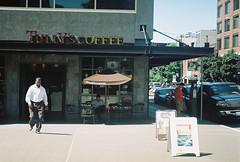 Tully's Coffee (goodfella2459) Tags: nikonf65 kodakgold200 35mm c41 film analog colour seattle cafe tullyscoffee coffeeshop city washington cars buildings