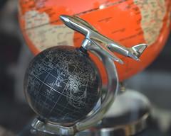 world traveler (remiklitsch) Tags: globes plane black orange metal nikon remiklitsch store window display city urban street la