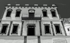 Old Building ( Romeikos Gialos Seafront - Myrina Town - Limnos) (BW )(Panasonic Lumix S1 & Lumix S 24-105mm f4 Zoom) (1 of 1) (markdbaynham) Tags: greece greek grecia greka greekisland greekholiday greeceaegean greektown greekaegean gr hellas hellenic food greekfood myrina mypina myrinatown myrinaharbour harbour panasonic lumix lumixer panasoniclumix panasonicleica panny northaegean northaegeanisland s1 drink dcs1 lumixdcs1 s lumixs1 lumixfullframe lumixs lumixszoom 24105mmf4 24105mm zoomlens lumixzoom lumixzoomlens boat ship people taverna tree church traditional landscape seascape seafront nightscape panasonics1 panasonicdcs1 limnos lemnos lemnosgreece limnosgreece greeklife