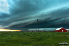 Red Barn Ranch (kevin-palmer) Tags: june summer storm stormy thunderstorm severe supercell sky weather clouds evening denton montana nikond750 tamron2470mmf28 farm ranch red barn windmill green grass shelfcloud