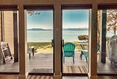 Brief stay at a bungalow on Lake Tahoe, California (lhboudreau) Tags: home house bungalow pation chair chairs table lake mountains laketahoe southlaketahoe california door doors slidingglassdoor lakeview shore backyard tree trees rental rentalunit wood rug rugs beachhouse