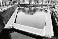 Limehouse Basin, London (a.pierre4840) Tags: olympus om3 zuiko 24mm f28 35mmfilm bw blackandwhite noiretblanc harbour reflection architecture perspective london england