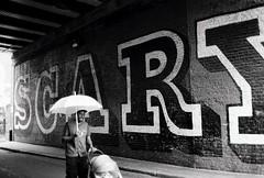 (a.pierre4840) Tags: olympus om3 zuiko 35mm f28 35mmfilm ilford ilfordhp5 hp5 hp5plus bw blackandwhite noiretblanc streetphotography streetart umbrella candid london england