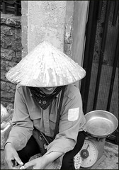 . (Out to Lunch) Tags: alley bach dang st saigon ho chi minh city vietnam monochrome blackwhite street selling woman hat hands mouth fence fuji xh1 xf1423r happyplanet asiafavorites