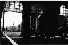 Into the dark (Elios.k) Tags: horizontal outdoors people many tourists door opening gate silhouette contrast bright dark street tunnel passage underpassage rijksmuseum streetphotography bicycles bike fiets cycling walk walking window light blackandwhite bw mono monochrome travel travelling may 2018 canon camera photography amsterdam museumplein netherlands nederland europe film analoguephotography scannedfilm kodaktrix400 analogfilm grain canona1 a1 analogcamera