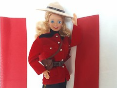 Canadian Barbie (Dolls of the World) #4928 from 1987 (VintageZealot) Tags: barbie mattel dotw dolls of the world canadian 4928 1987 80s 1980s canada rcmp royal mounted police traditional dress uniform vintage retro fashion doll clothing clothes outfit model modelling china super star superstar caucasian white blonde jewelry ring diamond crystal rhinestone red black yellow brown faux leather pleather vinyl boots pants trousers jodhpurs belt jacket coat purse satchel bag fanny pack tan beige cream hat plastic snaps cop officer cross strap