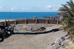 Costa Adeje, Santa Cruz de Tenerife, Canary Islands, Spain (wildhareuk) Tags: canaryislands canon canoneos500d parasol people sand sea seascape spain tamron18270mm tenerife tenerife2019 water bridge sandart tamron wood yellow img9463dxo