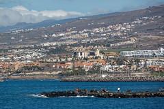Costa Adeje, Santa Cruz de Tenerife, Canary Islands, Spain (wildhareuk) Tags: canaryislands canon canoneos500d people sea seascape spain tamron18270mm tenerife tenerife2019 town water building tamron img9474dxo