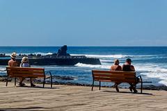 Costa Adeje, Santa Cruz de Tenerife, Canary Islands, Spain (wildhareuk) Tags: canaryislands canon canoneos500d people promenade sea seascape spain tamron18270mm tenerife tenerife2019 water bench rock tamron img9482dxo