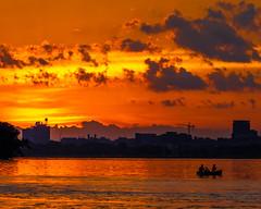 Sunset on Lake Monona (AChucksEyeView) Tags: sunset sunrise water lake orange red yellow sun boat landscape skyline urban clouds