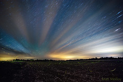 Stars, Clouds and Fireflies (Matt Molloy) Tags: nature night sky colorful stars clouds trails startrails lines milkyway galaxy trees field countryside landscape skyscape leedsandgrenville seeleysbay ontario canada explorecanada exploreontario mattmolloy timelapse photography canon timestack photoshop outdoors