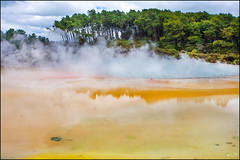 Champagne (katepedley) Tags: reflection water hotsprings geothermal waiotapu tapu sacred waters mineral geysers thermal volcanic rotorua taupo tvz geology yellow orange canon 5d 1740mm polariser northisland newzealand aotearoa nz north island new zealand champagne pool steam explore bayofplenty