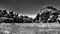 Across the Desert Grassland to Sandstone Columns and Pillars with the Needles Skyline Beyond (Black & White, Canyonlands National Park) (thor_mark ) Tags: azimuth190 blackwhite blueskies canyonwalls canyonlands canyonlandsnationalpark canyons capturenx2edited centralcanyonlands colorefexpro coloradoplateau confluenceoverlooktrail cyclonecanyon day4 desertgrassland desertlandscape desertmountainlandscape desertplantlife desertprairieland desertwildflowers highdesert hiketoconfluenceoverlook hikingtrail intermountainwest landscape layersofrock lookingsouth nature naturetrail needlesskyline nikond800e outside project365 sandstonecolumn sandstonepillar sandstonerockcolumn smallbush smallbushes sunny theneedlesdistrict trail utahhighdesert utahnationalparks2017 utah itedstates