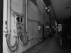 Osaka behind the scene (peaceblaster9) Tags: osaka 大阪 umeda 梅田 blackandwhite bnw bw blackwhite monochrome モノクローム モノクロ 白黒 wall pipe alley street ストリート
