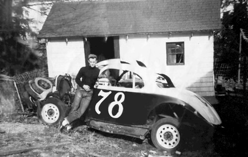Jack Malone poses with one of his stock cars behind the chicken coop at his Needham, MA house.