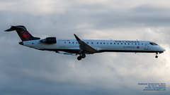 A Bombardier CRJ-900 in New Air Canada Livery Landing Against the YVR Clouds (AvgeekJoe) Tags: 100400mmf563 aircanada bombardier bombardiercrj705 bombardiercrj900 cfjjz cl6002d15 crj705 crj900 d7500 dslr nikon nikond7500 sigma sigma100400mmf563 sigma100400mmf563dgoshsmcontemporary aircraft airplane aviation jetliner plane telephotolens