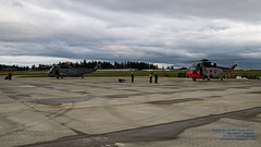 TWO SEA KINGS REVVING UP TO FLY A FAREWELL FLYPAST (AvgeekJoe) Tags: 12410 12417 4017 443cityofnewwestministermaritimehelicoptersquadron 443maritimehelicoptersquadron 443squadron 61245 61283 britishcolumbia ch124 ch124seaking ch124a ch124aseaking cyyj canada canadianarmedforces d5300 dslr helicopter importedkeywordtags navalaviation nikon nikond5300 rcaf register12410 register12417 royalcanadianairforce s61b saanichpeninsula seaking sikorskych124 sikorskych124seaking sikorskych124aseaking sikorskys61b sikorskyseaking tamron18400mm tamron18400mmf3563diiivchld thankyoucanada victoria victoriainternational victoriainternationalairport yyj airport cn61245 cn61283 chopper colourbird rotatingwings