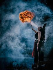 Gaby the fire breather (Dannis van der Heiden) Tags: firebreathing firebreather fire mist smoke firesmoke mystic schnitzeljacht water pond reflection grass angel nuenen netherlands nikond750 d750 tamron70210mmf4 mystery