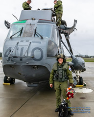 """Captain Carly the """"Sea Queen"""" Home Safe (AvgeekJoe) Tags: 12410 61245 britishcolumbia ch124 ch124seaking ch124a ch124aseaking cyyj canada canadianarmedforces d5300 dslr helicopter importedkeywordtags nikon nikond5300 register12410 royalcanadianairforce saanichpeninsula seaking sikorskych124aseaking sikorskys61b tamron18400mm tamron18400mmf3563diiivchld victoria victoriainternational victoriainternationalairport yyj airport bouquet cn61245 chopper ladyaircrew ladyinuniform ladypilot pilot rose roses"""