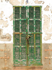 Locked (vertblu) Tags: door decay locked white green geometric lines wall beige rust closed paint geometry rusty shutter geometrical peelingpaint fasteners oldpaint shadesofgreen verticals paintedwood linien horizontals fastened crossinglines nr6 rustpatterns vertblu texture textures textur